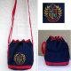 Bag: Blue w/ red trim, shoulder strap, embroidered emblem